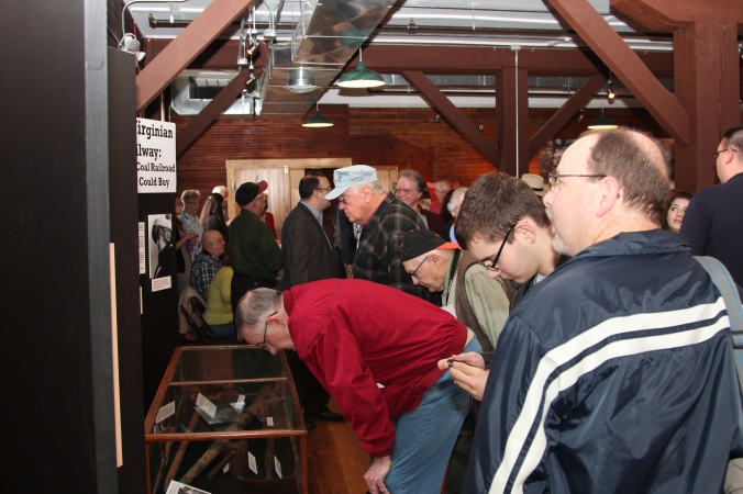 Visitors study artifacts pertaining to the construction of the Virginian Railway during the grand opening.